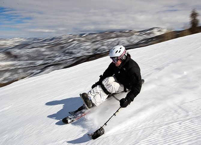 Monoskier Rebecca Shephard tears down the slopes at Steamboat Ski Area. After a traumatic ski accident left her paralyzed from the waist down, Shephard relearned how to ski through Challenge Aspen, a nonprofit that provides recreational opportuniies for people with disabilities.