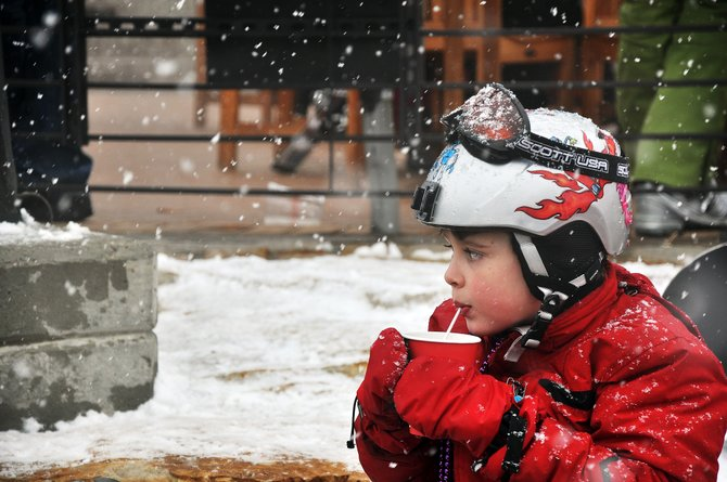 Ben Maschler, 7, sips apple cider Sunday in Gondola Square at Steamboat Ski Area while on vacation from New Jersey. Forecasters are calling for a chance of snow in Steamboat Springs every day through Friday.