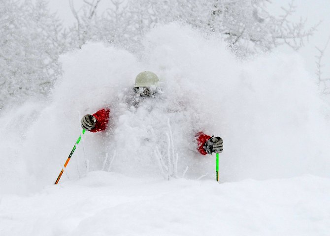 With 27 inches of fresh powder dumped on the ski resort this morning, hooting and hollering was heard all over the mountain. Skier Joe Kelly finds it hard to see or breathe on the way down Ted&#39;s Ridge. Photo/Larry Pierce