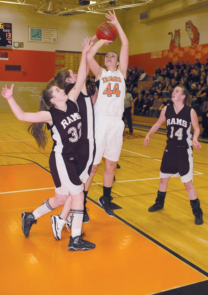 Hayden senior Erin Koehler takes a shot during the first half of Tuesday night&#39;s district playoff game against Soroco in Hayden. The Tigers held on in the closing seconds of the thrilling contest to escape with a 52-51 victory.