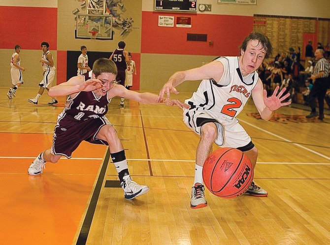 Hayden senior Hunter Johnston and Soroco junior Cody McCollum battle for a loose ball in the first half of Tuesday&#39;s district playoff game in Hayden.