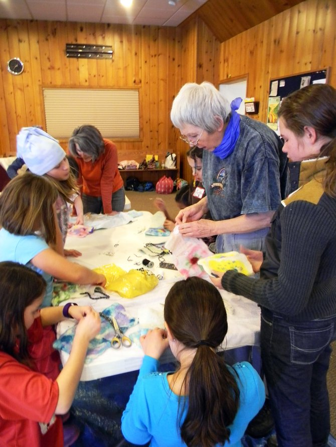 Routt County 4-H volunteer Rosemary Farrell teaches the art of felting wool to a group of local students Wednesday at a 4-H Fiber Arts Camp at United Methodist Church of Steamboat Springs. Routt County 4-H was a recipient of one of two $10,000 grants from Steamboat Ski &amp; Resort Corp.                                