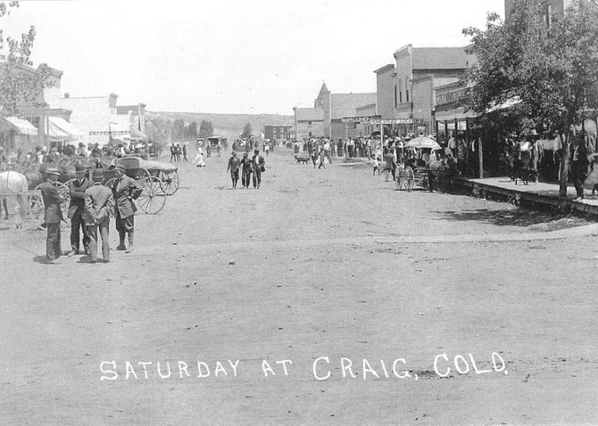 This photo shows a bustling Yampa Avenue at the time when the Simmons Rooming House was still in use. The rooming house, which is now being demolished to make way for a new Moffat County Fuller Center for Housing project, is the last structure visible on the right-hand side of the street.