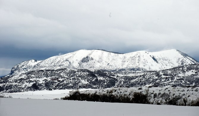 Wind-blown snow can be seen racing across the ridge of Sleeping Giant on Wednesday afternoon. On Thursday morning, wind knocked down power lines and caused interruptions in electrical service across Routt County.