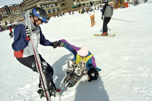 David Wikman helps Shadre Gaines, 15, stand up at the base of Steamboat Ski Area. The two were participating in 2007's Sunshine Kids Winter Games, which will return to Steamboat Springs this weekend.