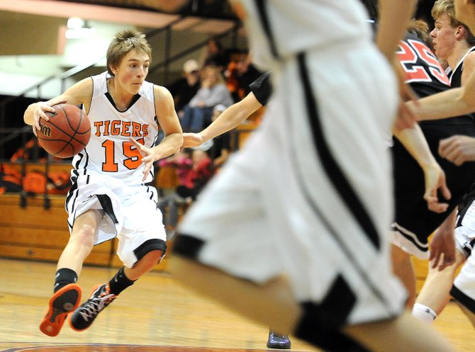 Hayden's Isaac Bridges drives the ball Saturday at the district tournament in Kremmling. The Tigers defeated the Paonia Eagles in an easy 73-57 win.