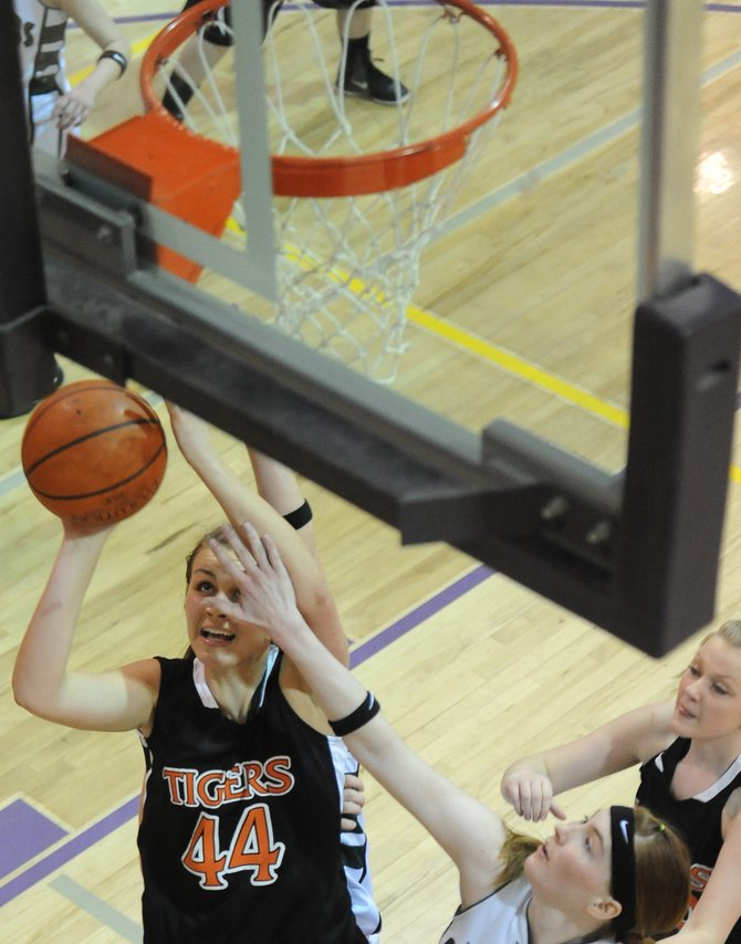 Haydens Erin Koehler puts up a shot Saturday at the district tournament in Kremmling. Koehler scored 26 points in the game to help the Tigers place third in the tournament.