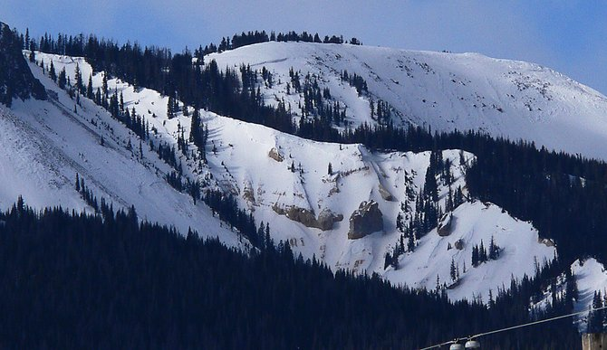 Avalanche expert Art Judson captured evidence of six avalanches in this photograph taken Sunday morning of the north side of Sand Mountain just west of Steamboat Lake. Judson estimated the largest fracture, seen just left near the top of the peak, was 6 or 7 feet deep.