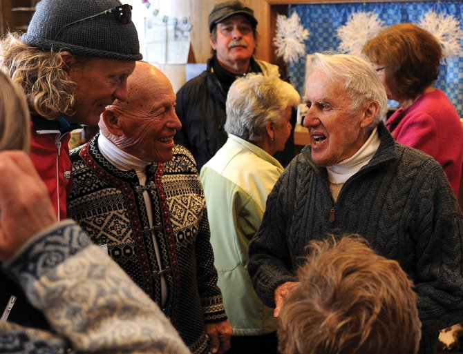 Sven Wiik, right, shared laughs with a large group of friends while celebrating his 91st birthday Sunday at Steamboat Ski Touring Center in Steamboat Springs.