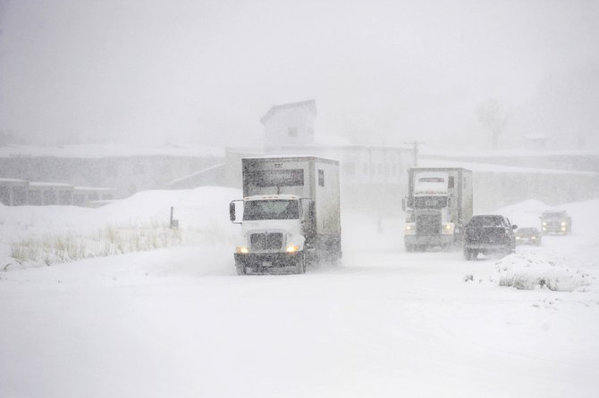 Semitrailers navigate snow on Shield Drive on Tuesday morning on the west side of Steamboat Springs.