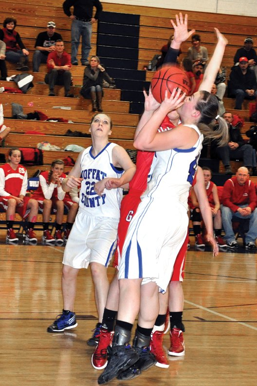 Annie Sadvar, a Moffat County High School senior, goes up for a shot Feb. 14 against Glenwood Springs at MCHS. Sadvar and fellow senior Melissa Camilletti stepped into a leadership role in their final season with the Bulldogs, helping guide the team to a second consecutive Sweet 16 appearance.