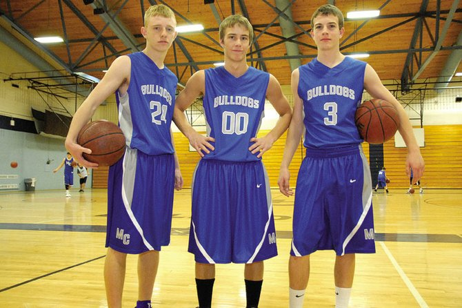 From left, Tyler Davis, Taft Cleverly and Joe Camilletti each contributed to the Moffat County High School boys varsity basketball team in the 2011-12 season. Head coach Eric Hamilton said Cleverly, a sophomore, and freshmen Camilletti and Davis are the building blocks for a successful future for the program.