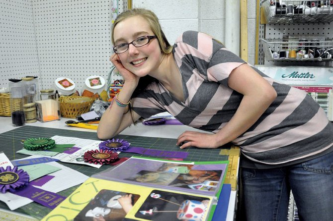 Allie Dilldine, 13, poses near awards she's amassed for cake decorating. Allie's awards include a grand champion ribbon she won at the 2011 Colorado State Fair.