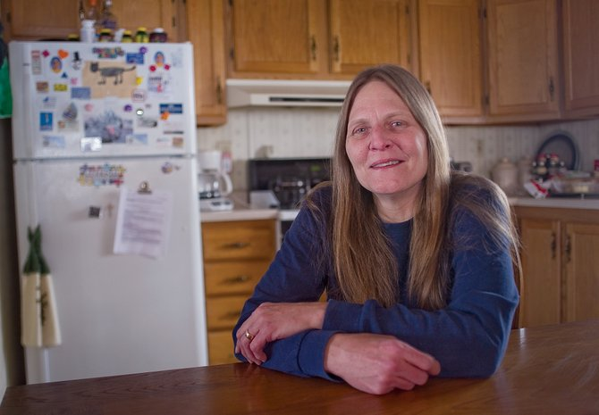 Meredith Herndon sits in the kitchen of her Steamboat Springs home Wednesday afternoon. Herndon suffers from atypical trigeminal neuralgia, an illness that sends near-constant waves of pain through the nerves and muscles in her face.