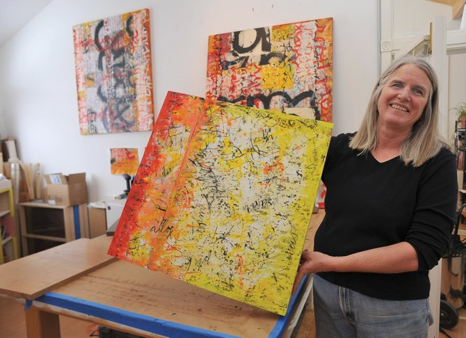 Laura Wait presents some of her work in her Steamboat studio. Wait's newest show debuts Friday at K. Saari Gallery.
