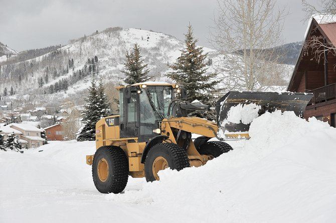 Ben Schreiner, of Rocky Mountain Asphalt, plows a driveway on Cherry Drive after a record snowstorm Feb. 19 and 20. Several winter storms in February helped people in the Steamboat Springs area shrug off a slow start to the winter.