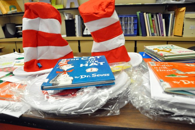 Dr. Seuss books and hats for Read Across America Day wait in Krista Schenck's classroom Thursday afternoon at Moffat County High School. Schenck, Moffat County Education Association co-president, helped organize reading activities for the annual event, which took place Friday in Craig elementary schools.