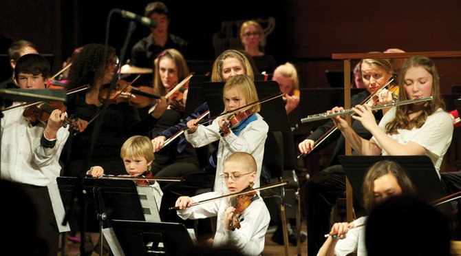 "Jacob VanDerWerf, 11, bottom center, will perform in a string ensemble in the Steamboat Symphony Orchestra's education and outreach showcase ""Together in Concert"" at 7 p.m. Tuesday at Library Hall at Bud Werner Memorial Library."