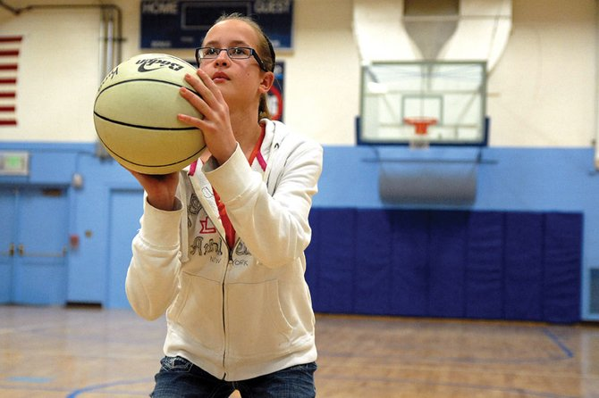 Josey King, a 13-year-old Craig Middle School seventh-grader, practices free throws Friday at CMS. King finished second in the Colorado state Elks Lodge Hoops Shoot tournament Feb. 25 in Salida after taking first place in the local and district stages.