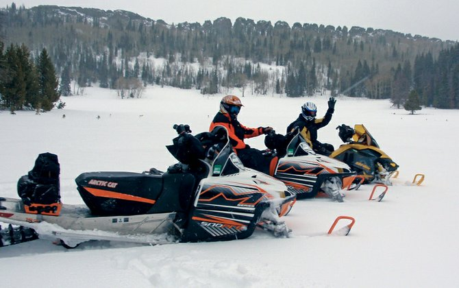 Joe Tonso, wearing orange, and Bill Spicer, yellow, pause for a photo while enjoying one of the many open parks maintained by the Northwest Colorado Snowmobile Club. Despite a late start to the season, Tonso said conditions are now prime for riding.