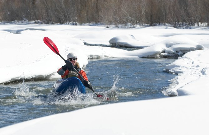 Grant Fowler makes his way down the Yampa River in a kayak Monday afternoon. The combined Yampa and White river basins stood at 80 percent of average moisture stored in the snow Monday, according to the Natural Resources Conservation Service.