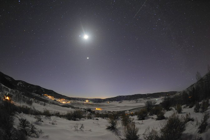 The dazzling duo of Venus and Jupiter light up our evening sky this week. In this snowy scene, captured on Feb. 26 overlooking Stagecoach, the brightest object is the moon. Jupiter is just to the left of the moon, and Venus is below. Watch these two planets converge during the next week until they appear side by side on March 13.