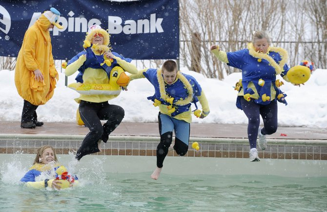 Members of The Rubber Duckies team jump into the water during the 2010 Penguin Plunge event. This year's event will be held March 24 at Catamount Ranch & Club, and a kickoff party will be held from 5 to 7 p.m. Thursday at Carl's Tavern.