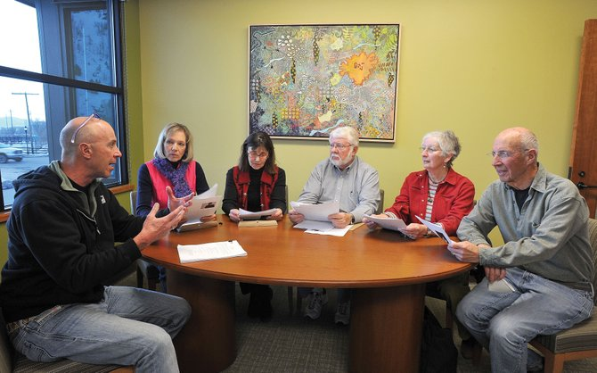 Stuart Handloff, left, discusses the scripts for this Sunday's Shinsai theatrical performance with a group of readers participating in the fundraiser for Japan. From second left, Sherry Benson, Claudia Droel, Mike Forney, Judt Gunthorpe and John Morrison.