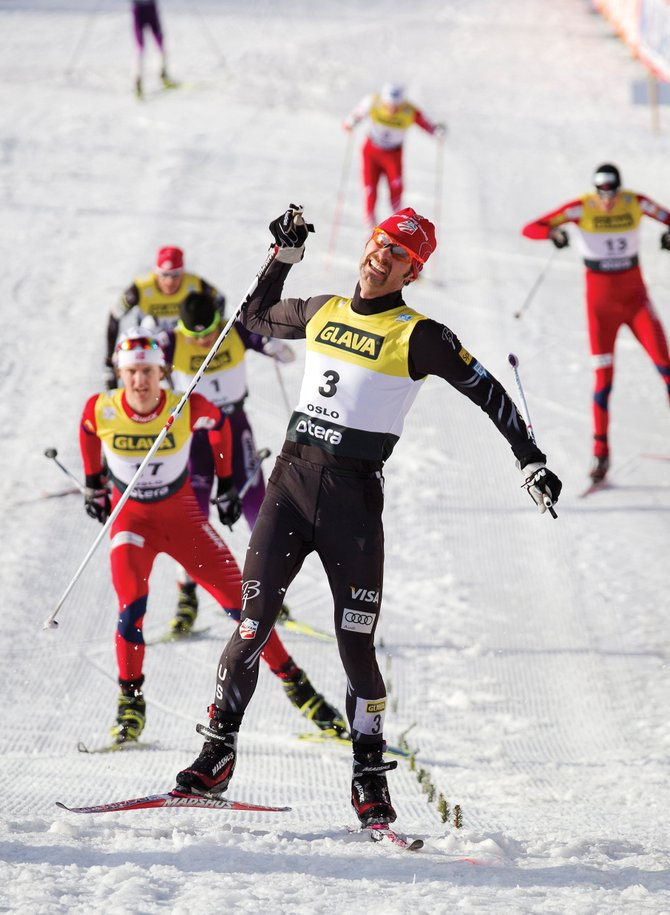 Steamboat Springs' Bryan Fletcher reacts as he crosses the finish line to win the FIS Nordic Combined World Cup competition Saturday in Oslo, Norway.