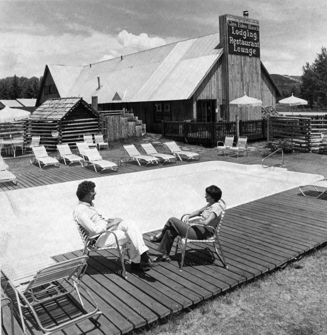 The late Glen Eden Resort manager and partner Frank Leonard, left, chats poolside with a guest in 1981.