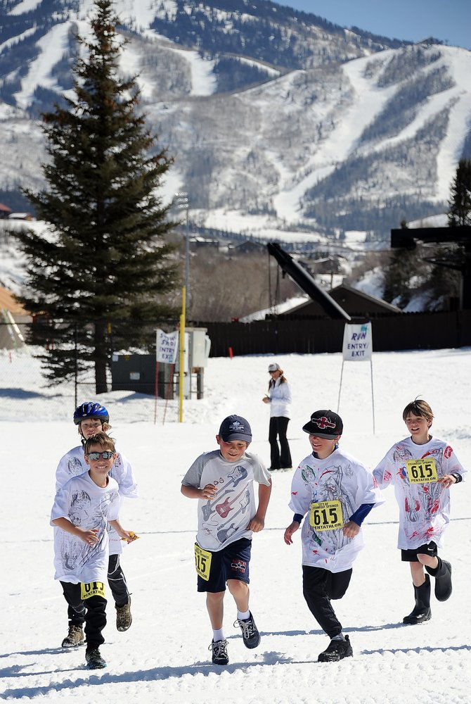 Members of the Zombie Zoomers team charge toward the finish line of Saturday's Steamboat Pentathlon. The event drew more than 200 competitors to hike, run, ski, snowshoe and bike.