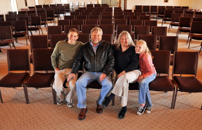 Parishioners of Hayden's Mission of Grace Baptist Church have set up a fund to help their preacher Doug Zirkle receive a kidney transplant. Pictured in the church are Doug and his wife, Lisa, and their children Caroline and Chris.
