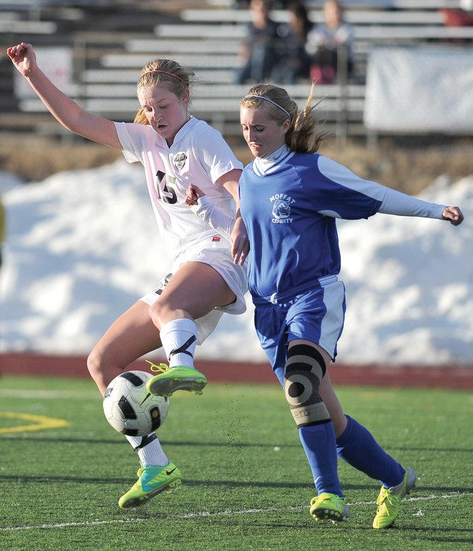 Steamboat's Kelbi Rogers battles a Moffat County defender for possession of the ball in the first half of Tuesday afternoon's game in Steamboat Springs.