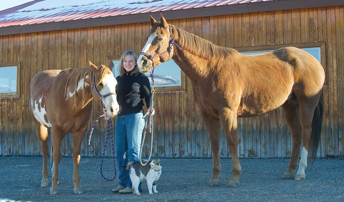 Mr. Ed's Got Nothing on These Equines: Christina Haxton with her human-helping horses Deuce, left, and Kola.