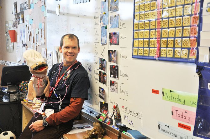 Grady Turner uses a chef puppet to help him teach the value of eating healthy foods in the classroom. Turner said he was motivated to use healthy food as a learning tool when he noticed childhood obesity was on the rise.