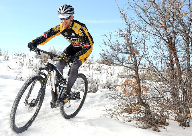 Snow Rider: Nate Bird, of Honey Stinger, hits the snowy singletrack on Emerald Mountain.