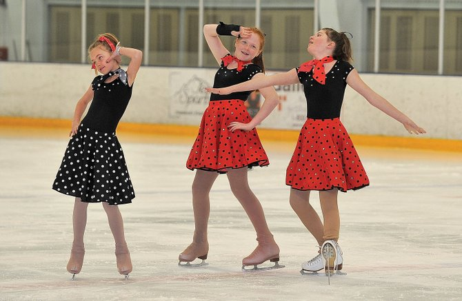 "Steamboat Springs Figure Skating Club members, from left, Alison Famulare, Mariah Walker and Sage Turek wrap up their performance of ""You Can't Stop the Beat"" during a rehearsal for the ""Broadway on Ice"" spring ice show. The show will take place at 7 p.m. today and Saturday at Howelsen Ice Arena."