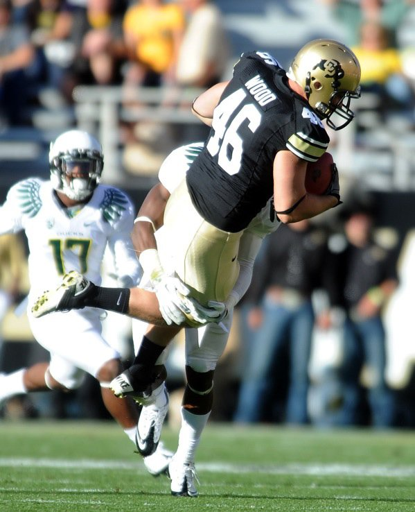 The University of Colorado's Alex Wood is picked up and slammed down by Ifo Ekpre-Olumu, of Oregon, on Oct. 22. Wood, a Steamboat Springs High School graduate, opened atop the depth chart at fullback for spring football at Colorado.
