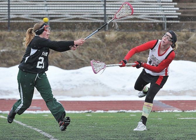 Steamboat Springs Aleigh Aurin takes a shot during Monday afternoon's girls lacrosse game at Gardner Field against Summit County.