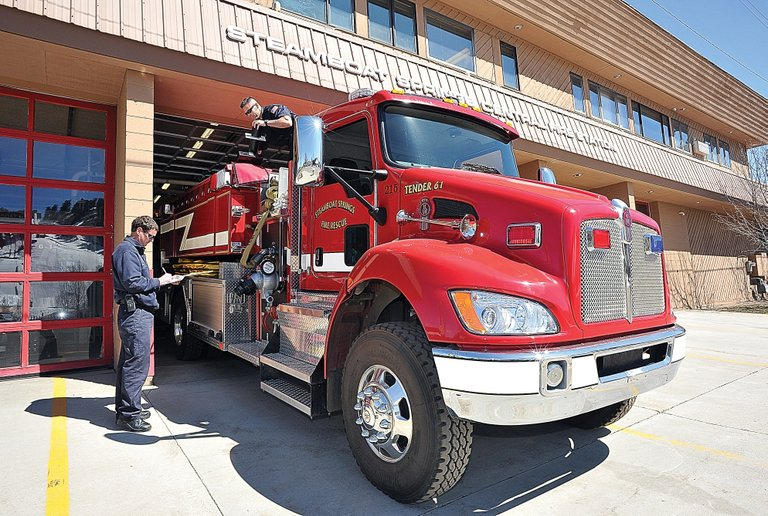 Steamboat Springs Fire Rescue firefighters Brian Shively, left, and Scott Hetrick inspect a fire truck at the Steamboat Springs Central Fire Station on Tuesday afternoon. At Tuesday's Steamboat Springs City Council meeting, city officials discussed the possibility of selling the current police headquarters and fire station at 840 Yampa St. and constructing a new public safety campus in west Steamboat.