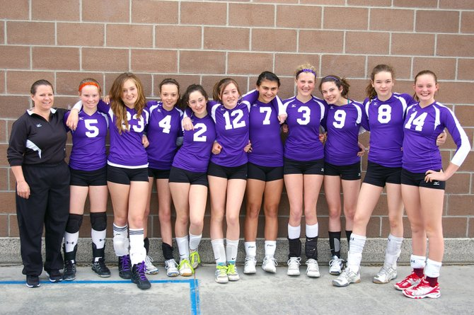 Members of the Whiteout 14s Black club volleyball team include, from left, coach Kathy Hockett, Jessika Hockett, Natalee Wirth, Sydney Weber, Anna Skubiz, Riley Toye, Maddie Labor, Ty Kortas, Brittney Starks, Libby Stanford and Jenna Miller. Not pictured are Temsup Techarukpong and assistant coach Mytina Eckhaus.