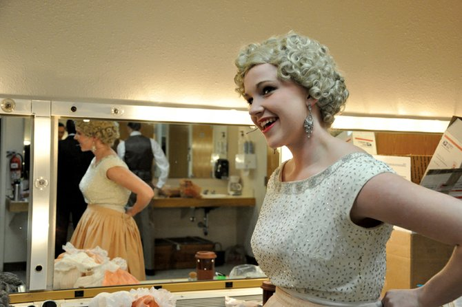 "Kat Thompson, a Moffat County High School senior, puts the finishing touches on her costume before a dress rehearsal for ""Rehearsal for Murder"" on Monday night at the high school. The play opens at 7 p.m. Thursday at the MCHS auditorium, 900 Finley Lane."