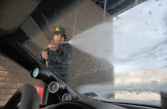 Diego Medana cleans his car at a car wash Wednesday afternoon on the west side of Steamboat Springs. Warm weather and a promising forecast had many drivers thinking about removing some of that winter grime from their cars. The record temperature for Saturday is a reading of 60 degrees recorded in 1986, according to the Climate Center. The National Weather Service is forecasting Saturdays high will reach 65.