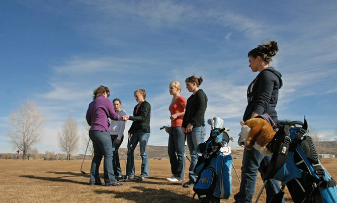 The Moffat County High School girls golf team chats before practice March 16 on the practice green at Yampa Valley Golf Course, 2179 Colorado Highway 394. Pictured, from left, are coach Ann Marie Roberts, returning sophomore Caitlin Harjes, freshman Katelyn Peroulis, Junior Alex Bulla, freshman Katie Rice and returning senior Sam Fox. Sophomore Shianna Dockins is not pictured.