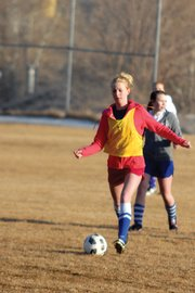 Bailey Hellander, a Moffat County High School junior, looks to clear the ball out of the defensive zone March 7 outside MCHS. The MCHS girls varsity soccer team has won five games each of the past two seasons, tying a school record, and the Bulldogs will look to make a push for the playoffs this season.
