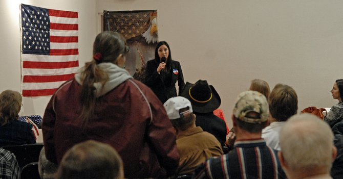 A Craig resident poses a question to Tisha Casida, an Independent candidate running for Colorado's Third Congressional District, during a March 1 meeting of the Bears Ears Tea Party Patriots at The Center of Craig, 601 Yampa Ave. The local chapter is a grassroots group focused on educating local residents on candidates and issues facing the nation.