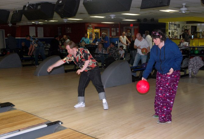 Kelly Chambers, left, and Jamie Kaminski bowl in a Wednesday night city league that brings together community members and Horizons Specialized Services clients with developmental disabilities. 