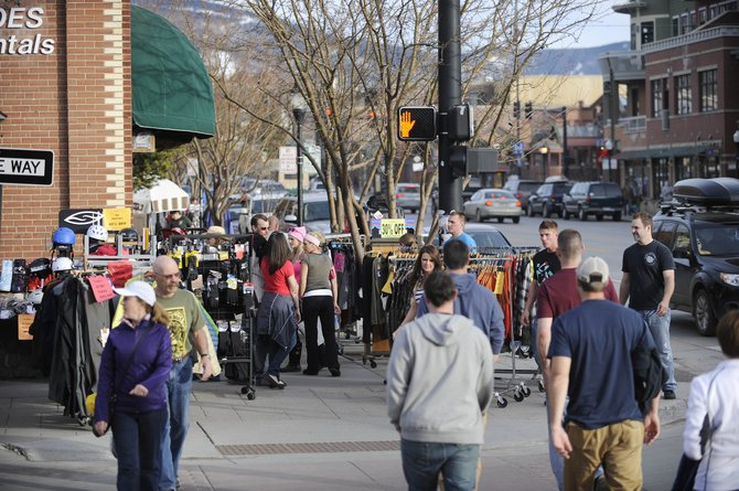 Warm weather Friday and Saturday in Steamboat made for a busy downtown as local businesses held sidewalk sales like this one Saturday at Straightline Sports at Seventh Street and Lincoln Avenue.
