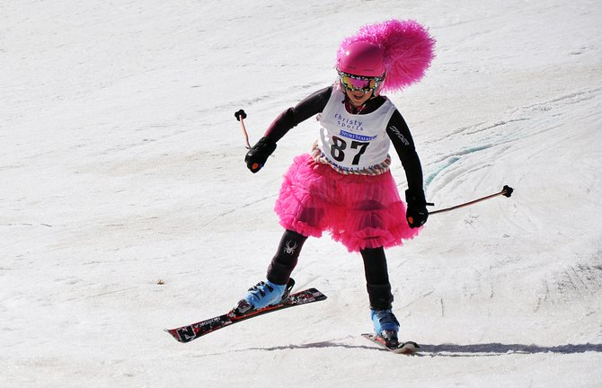 Alex Blair nears the finish line Sunday during a race at Howelsen Hill. Steamboat Springs Winter Sports Club athletes ended their ski season Sunday with a festive race.