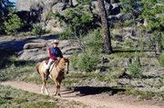 Craig resident Ken Wolgram gallops atop his horse, Awesomes Fire N Ice, during a North American Trail Ride Conference competition in Evergreen. The team participated in 12 NATRC events in 2011, and for the first time in the organizations history, took home all four national trophies.